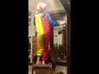 college girl dances in clown costume